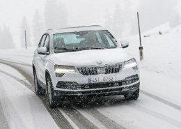 SKODA SUV driving through snow