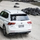 A white Volkswagen Tiguan SUV parked on a beach.