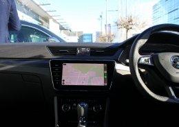 SKODA display screen with Apple CarPlay navigation connectivity displayed.
