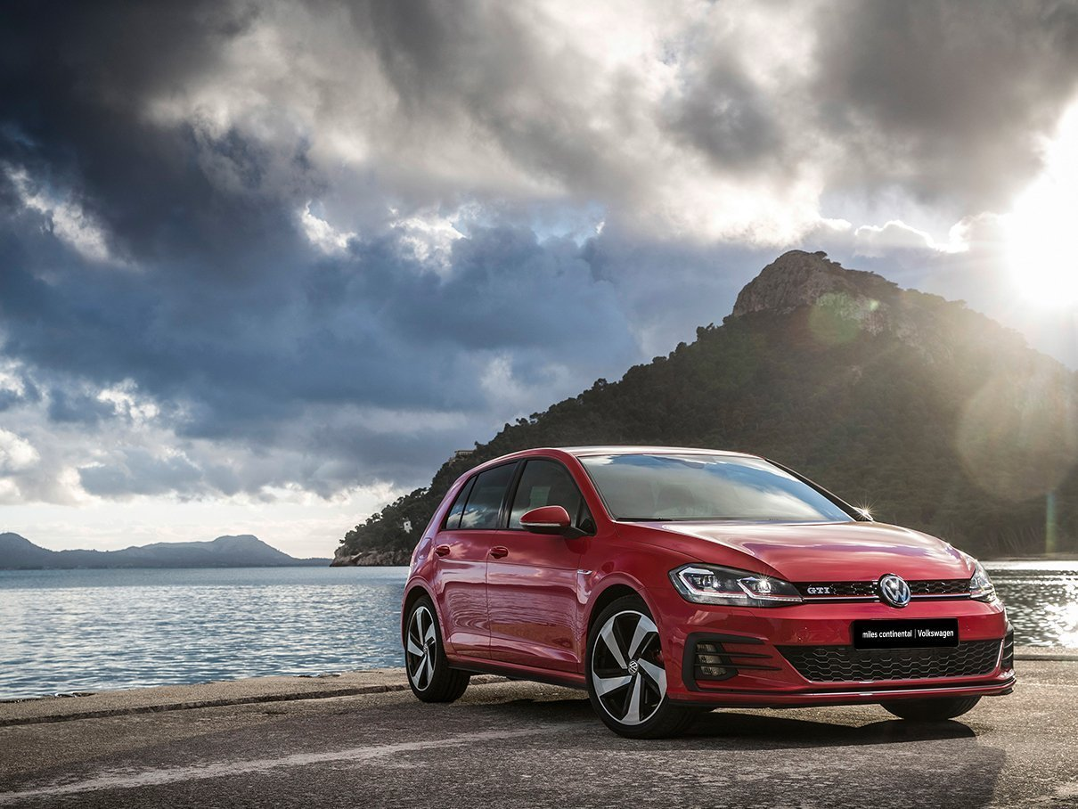 Red Golf GTI Luxury on waterfront