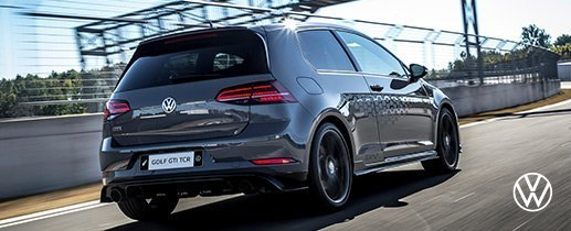 Grey Volkswagen Golf GTI TCR speeding on race track