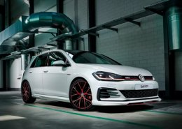 White Volkswagen Golf GTI with Oettinger body kit with red accents in a garage.