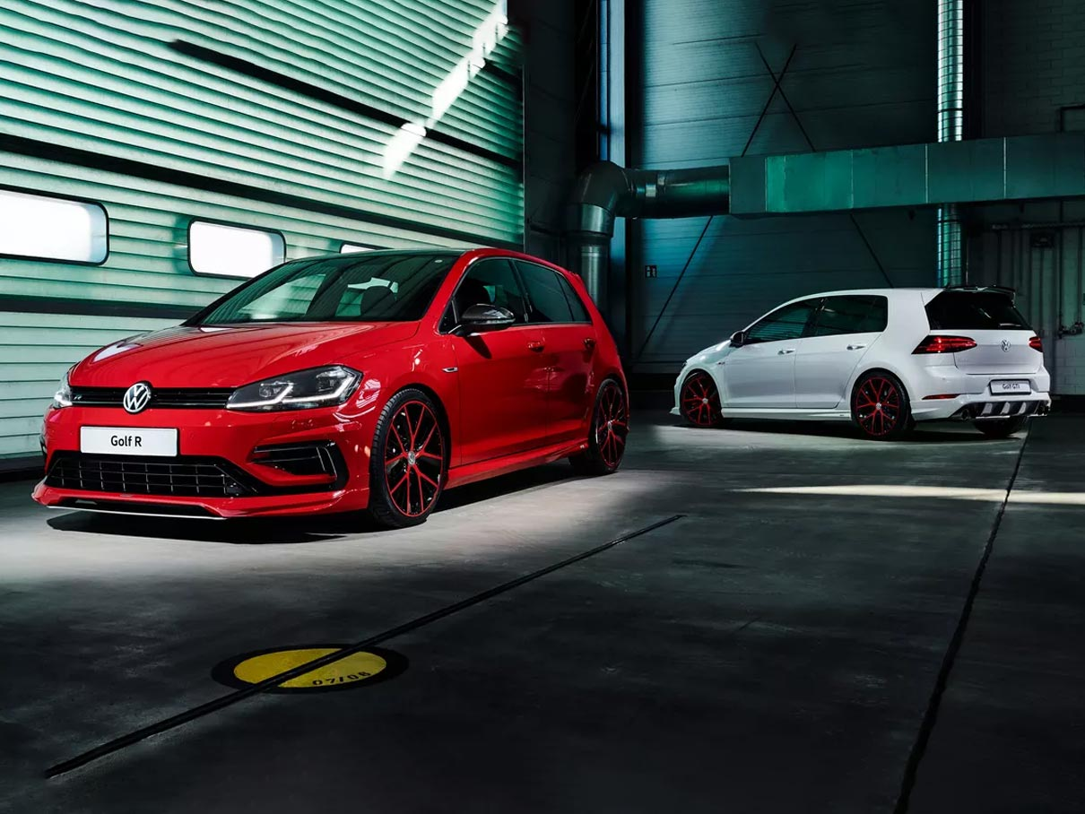 Two Volkswagen Golf GTI's with Oettinger Body kits parked in a garage.